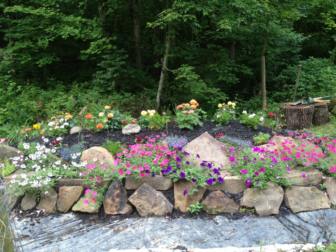 rock wall flower bed trusper. Black Bedroom Furniture Sets. Home Design Ideas