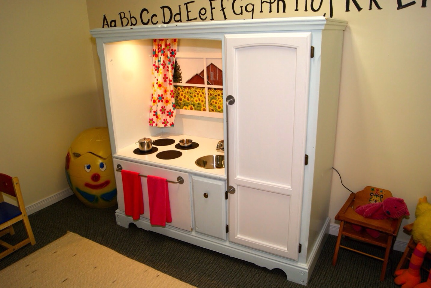 Turn old furniture into a mini kitchen set for the kids for Cheap kids kitchen set